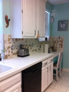 Removing ceramic tile backsplash
