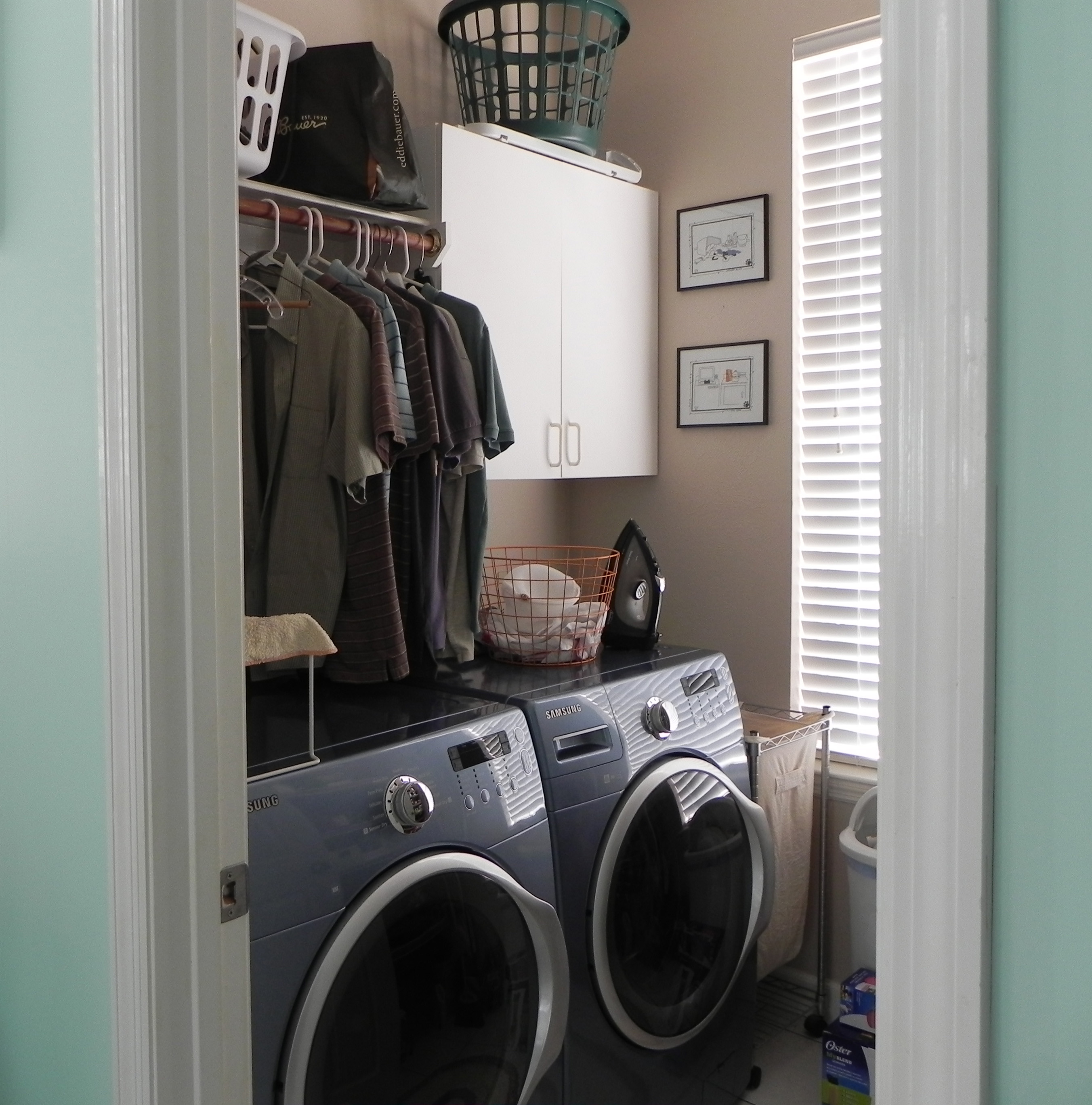 Master closet with diet coke in hand for Masters laundry