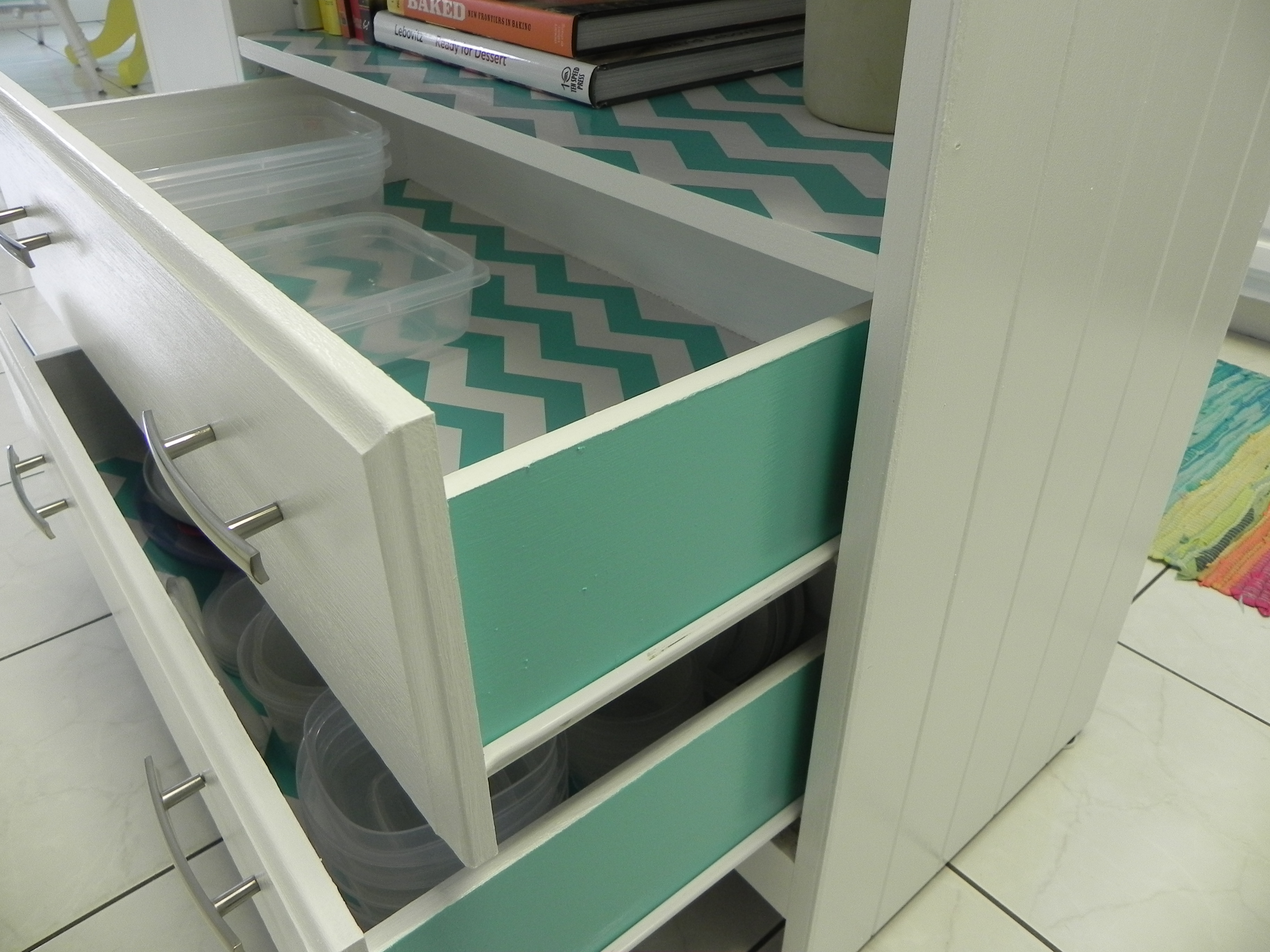 upcycled kitchen island with diet coke in hand